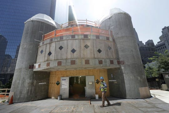 A construction worker walks in front of the St. Nicholas National Shrine in New York in this Aug. 10, 2017 photo. The original church was destroyed by the 9/11 attacks, and work on the new building has been halted since December of 2017 due to funding shortages.