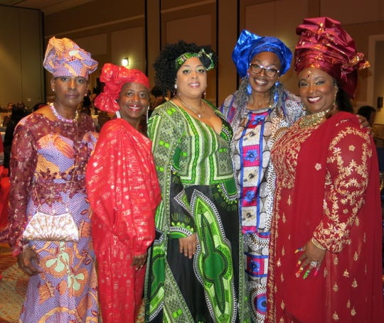 "Krewe Harambee is famous for its ""hat ladies,"" who wear the most stunning creations   with their colorful ensembles year-after-year. Among those posing for a photo op at Sonkofa 2020:  Stephanie Williams, Vanessa Monroe, LaQuita Rachal, Ene Thomas, Barbara Casey."
