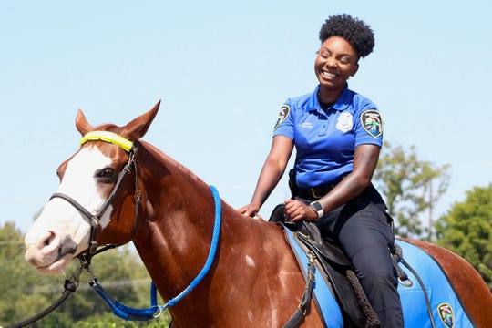 Officer Catari Jackson sits on Shreveport Police Department horse Rock for photos on Thursday, Sept. 12, 2019.