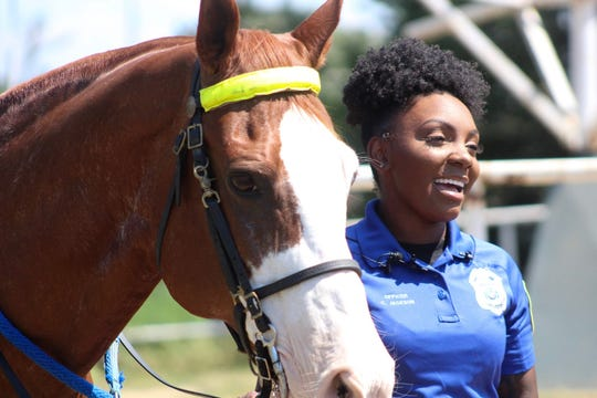 Officer Catari Jackson with Shreveport Police Department horse Rock on Thursday, Sept. 12, 2019, for interviews with local media.