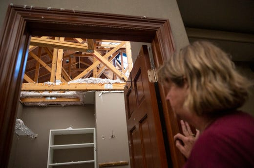 Julie Nielsen looks at the damage done to her home on Thursday, Sept. 12, 2019. Three tornadoes touched down in Sioux Falls on Tuesday, Sept. 10, 2019.