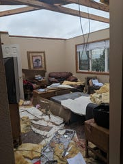 An EF2 tornado tore the roof off of Chère Rosa de Sharon top floor apartment near Kiwanis Avenue and 41st Street late Tuesday night, displacing her, her daughter and her boyfriend.