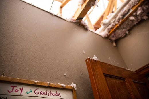 "A white board in Julie and Mark Nielsen's tornado damaged home reads ""Joy and Gratitude"" on Thursday, Sept. 12, 2019. Three tornadoes touched down in Sioux Falls on Tuesday, Sept. 10, 2019."