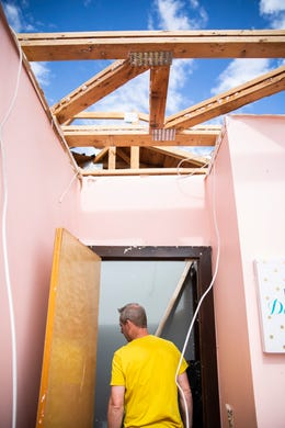 Steve Gokie walks through his daughters bedroom to look at the tornado damage on Thursday, Sept. 12, 2019. Gokie's wife and two children were in that room when the roof collapsed trapping them under debris after three tornadoes touched down in Sioux Falls on Tuesday, Sept. 10, 2019.