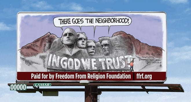 """Billboards will be going up in Sioux Falls, Rapid City and Pierre protesting the new state law requiring """"In God We Trust"""" to be posted in all public schools."""