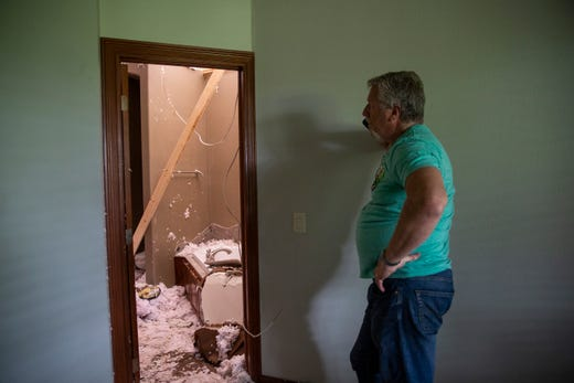 Mark Nielsen looks at the damage done to his home on Thursday, Sept. 12, 2019. Three tornadoes touched down in Sioux Falls on Tuesday, Sept. 10, 2019.