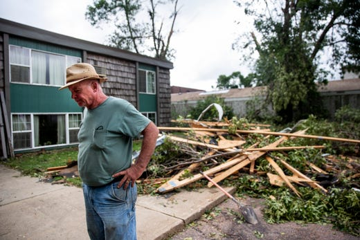 After three tornadoes touched down in Sioux Falls,  Dan Horsted looks at the damage done to his property, Horsted Properties on Thursday, Sept. 12, 2019. A roof from one of the buildings was torn off during the tornado.