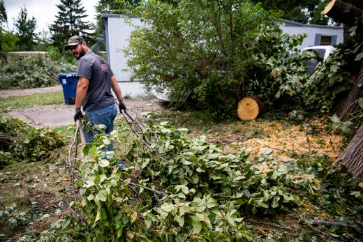 After tornadoes touched down in Sioux Falls, crews clean up Johnson Estates on Thursday, Sept. 12, 2019.