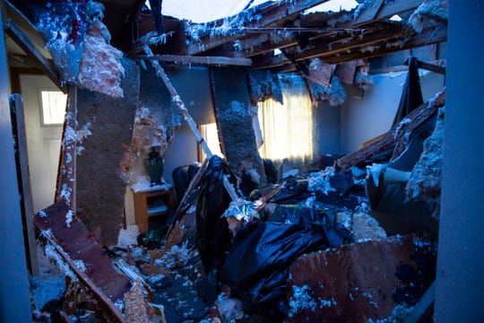 The Alberty's living room is damaged after tornados ripped through Sioux Falls on Thursday, Sept. 12, 2019.