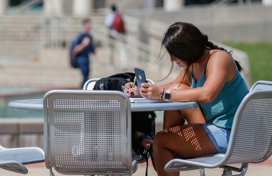 Alexis Ramirez, a sophomore at Missouri State University, studies biology next to the fountain on campus on Thursday, Sep. 12, 2019, in Springfield, Mo.