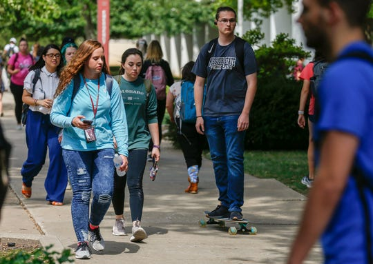 Students walk on campus at Missouri State University on Thursday, Sep. 12, 2019, in Springfield, Mo.