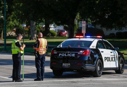 Police investigate the scene at Division Street and Benton Avenue where a pedestrian was killed after he was hit by a van on Thursday.