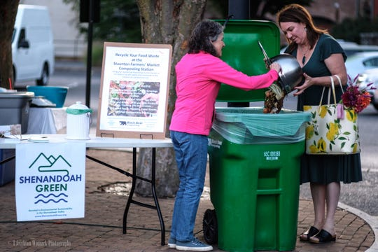 Lindsay Curran dropped off the first bucket of food waste at the Staunton Farmers' Market composting station on Saturday, Sept. 7.
