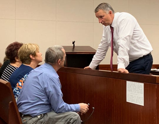 Chief Assistant State Attorney Tom Bakkedahl speaks to Lena and Bill Andrews, parents of murder victim Diana Duve, before a pretrial hearing for murder suspect Michael Jones Sept. 12, 2019.