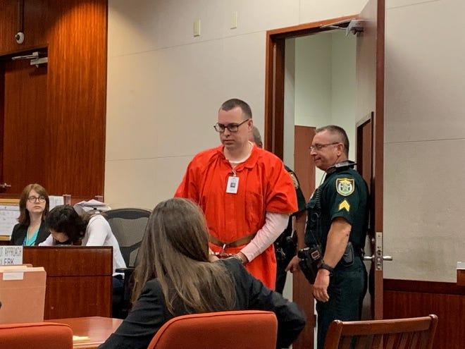 Murder suspect Michael D. Jones enters court for a pretrial hearing before Indian River County Circuit Judge Dan Vaughn Sept. 12, 2019.