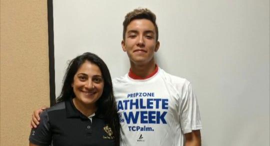 Treasure Coast swimmer Sebastian Paez  and coach Lorraine Campanaro