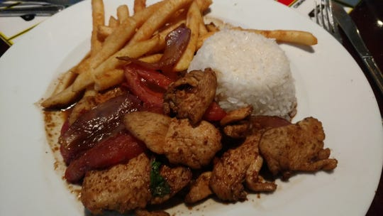Pollo saltado and lomo saltado are pieces of chicken breast or sirloin steak treated to a Peruvian marinade before being stir-fried with onions and tomatoes. Surprisingly, both plain white rice and tantalizingly spiced French fried potatoes accompany this entrée at Inti International Restaurant.