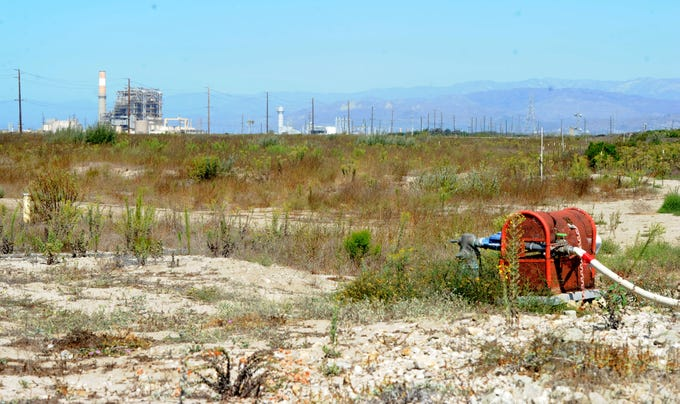 A patch of empty land in the northeast corner of West Fifth Street near South Harbor Boulevard in Oxnard is the site of a nearly 300-home development.