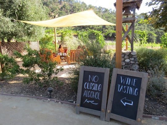 Outdoor seating areas at Old Creek Ranch Winery between Ventura and Casitas Springs are under fire from the Ventura County Planning Commission, which says they represent a non-permitted expansion of the winery's operations.