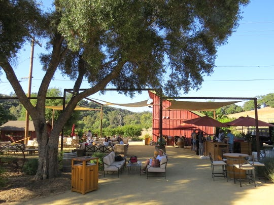 A shaded area created on the footprint of a former barn serves as the outdoor tasting room at Old Creek Ranch Winery between Ventura and Casitas Springs.