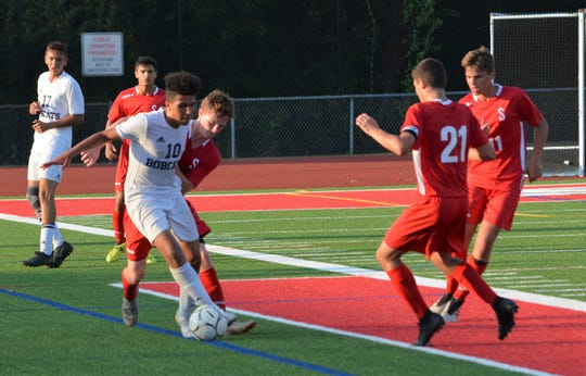 Byram Hills forward Yusuf Havez battles with Somers defender Sean Dickson late in the second half of the Bobcats' 4-3 win on Sept. 11, 2019 at Somers High School.