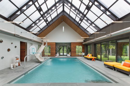 A custom-built Armonk home built for a co-founder of Equinox Gyms includes an indoor pool and a spa area covered by a retractable glass ceiling.