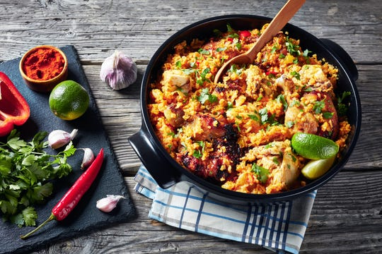 Arroz con pollo is the perfect nutritious meal for repurposing leftover chicken or rice.