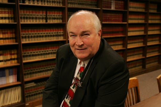 Larry Sullivan poses for a photograph on Dec. 23, 2004. Sullivan served as Delaware's chief public defender for 39 years.