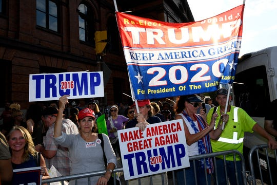 Supporters of President Donald Trump gather near the U.S. House Republican Member Retreat, Thursday, Sept. 12, in Baltimore.