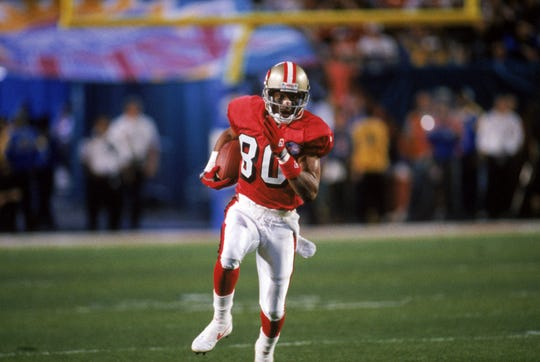 Wide receiver Jerry Rice #80 of the San Francisco 49ers runs with the ball during Super Bowl XXIX against the San Diego Chargers at Joe Robbie Stadium on January 29, 1995 in Miami.  The 49ers won 49-26.