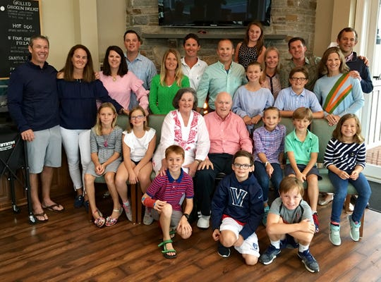Larry Sullivan is joined by his wife Kate, their six children and their spouses and their 11 grandchildren at Sullivan's 80th birthday party.