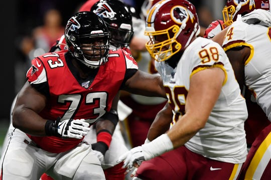 Atlanta Falcons offensive tackle Matt Gono (73) works against Washington Redskins defensive end Matthew Ioannidis (98) during the first half an NFL preseason football game.