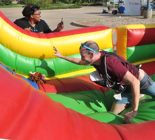 Wichita Falls Public Information Officer Eric Crosslin participates in the Child Care Partners Playground Warriors obstacle course during the Texoma Gives annual fundraising event held in the parking lot of the MPEC Thursday morning.
