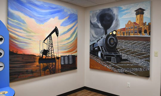 Several bold paintings by local artist Marsha Wright-Reeves depict aspects of North Texas history in the museum's ne childrens exhibit.
