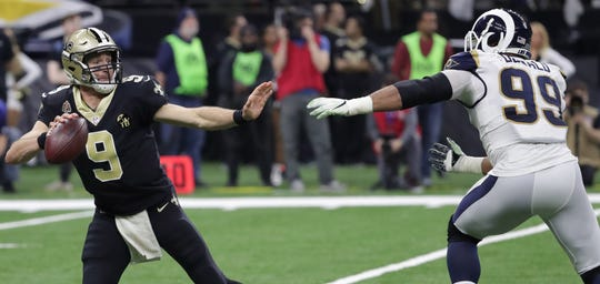 Drew Brees and the Saints will look to fend off Aaron Donald and the Rams in Sunday's NFC title game rematch.