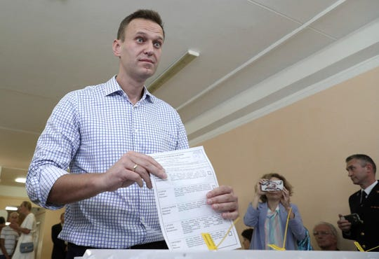 Russian police raid opposition figures in 43 cities after Kremlin's big election losses