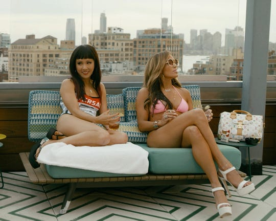 """Jennifer Lopez (right, with Constance Wu) is a likely Oscar contender for the crowd-pleasing """"Hustlers."""""""