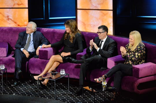Caitlyn Jenner, who shared a couch with Robert De Niro, Adam Carolla and Caroline Rhea, kept a smile on her face throughout the evening.