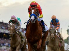 Justify wins the running of the 2018 Belmont Stakes and completes the Triple Crown.
