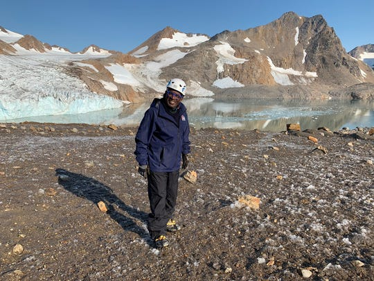 Al Roker poses in front of the Apusiaajik Glacier in Greenland.