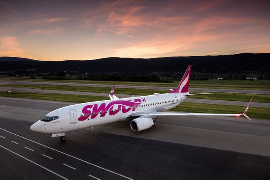 A Boeing 737 belonging to Canadian budget carrier Swoop was forced to make an emergency landing in British Columbia Tuesday after a bird strike caused an engine fire.