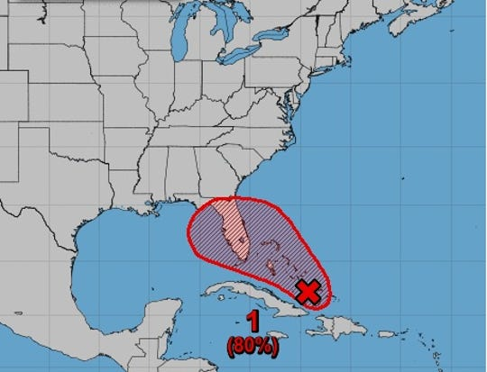 A weather disturbance (red x) has an 80% chance of strengthening into a tropical depression or storm somewhere within the red shaded area over the next five days.