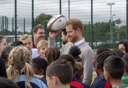 Britain's Prince Harry, Duke of Sussex interacts with participants during his visit to the Rugby Football Union (RFU) All Schools programme at Lealands High School in Luton, south east Bedfordshire on September 12, 2019. (Photo by ARTHUR EDWARDS / POOL / AFP)ARTHUR EDWARDS/AFP/Getty Images ORIG FILE ID: AFP_1K81PC