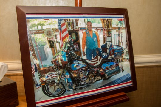 Mourners gather for Millstone resident Al DeRosa's funeral. He was the oldest member of the Blue Knights Law Enforcement Motorcycle Club as well as a retired NYPD officer and Air Force veteran. Friday, September 13th, 2019, in Freehold, New Jersey. (Contributor: EvaJo Alvarez)