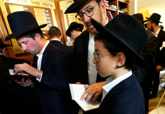 Mourners attend the funeral service for Rabbi Shlomo Gissinger at Khal Zichron Yaakov synagogue in Lakewood, N.J. on Friday, Sept. 13, 2019.