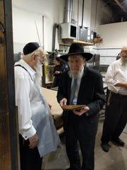Rabbi Shlomo Gissinger Zatzal (center) was a pillar of the Orthodox Jewish community in Lakewood.