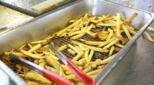 This is what many come to the West Texas Fair & Rodeo for - Aggie Fries. For less than $5, you get a boatload of fried potatoes this side of College Station.