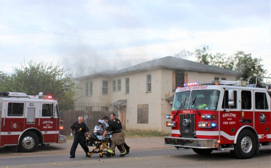 A person found inside a two-story structure on fire in south Abilene on Friday is taken by gurney to an ambulance. The victim was the only person inside and was treated for buns and smoke inhalation. Sept. 13 2019