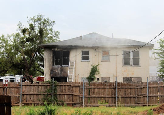 A view of the back of a two-story house in the 1000 block of Chestnut Street show fire damage Friday morning. Abilene firefighters responded to the blaze about 8:30 a.m.