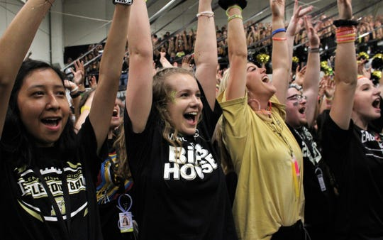 """Miah Dennis, second from the left, and other seniors scream after singing the school song, """"Dear Old Abilene High,"""" to conclude Friday's pep rally at Eagle Gymnasium for the Crosstown Showdown with Cooper High."""